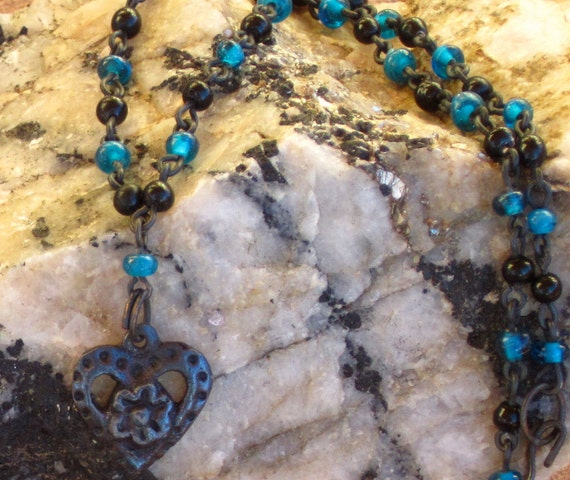 Delicate Necklace of Blue and Black Glass Beads With Metal Heart and Flower Pendant