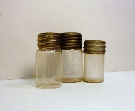 small glass jars tin lids vintage 1910 from watchmakers shop