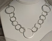 Forty inch well-made brushed sterling silver necklace.