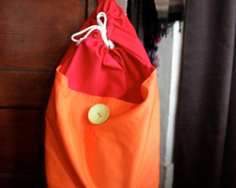 large laundry bag with straps - red with orange pocket