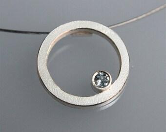"Contemporary handmade  silver pendant ""Q "" with blue topaz"