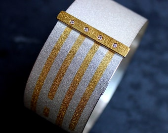 Sterling silver bracelet with 24kt gold kum boo and 4 diamonds