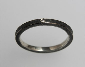 Minimalistic contemporary stacking ring in oxidized silver with diamond