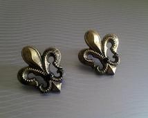 Lovely Legend: Bronze wooden fleur de lis charms, silver post earrings.