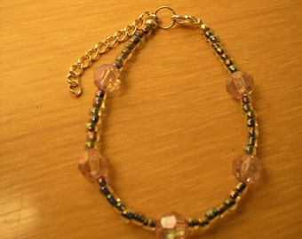 Rainbow glass seed beads, faceted acrylic rounds in pink  bracelet