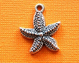 12 STARFISH silver charms or pendants  . 22mm x 19mm chs0699