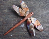 carved cedar -wood and copper dragonfly