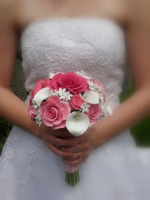 Absolutely elegant bouquet with pink roses, calla lillies and stephanotis flowers