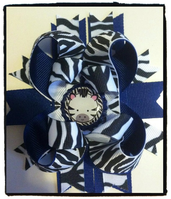 blue and zebra bow  with bottle cap center