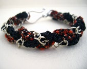 Exotic crimson red, black and silver braided bracelet