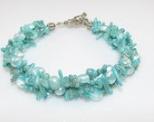 turquoise colored 3 layer woven pearl and coral bracelet