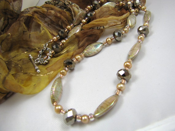 beige mother of pearl and gunmetal crystal gemstone necklace