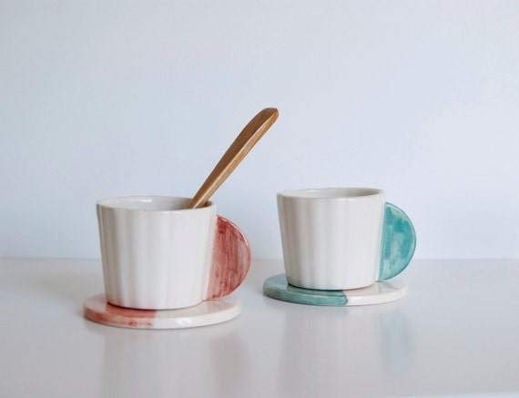 Set of two ceramic coffee cups with dish
