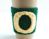 Green and yellow Oregon Ducks coffee cozy by The Cozy Project
