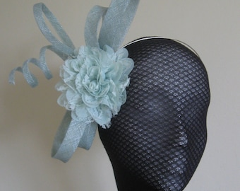 Soft mint green fascinator with  fabric flower