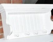 Children's wall shelf in distressed white