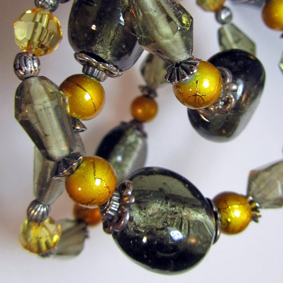 Gray and yellow glass bead necklace with silver toned accents