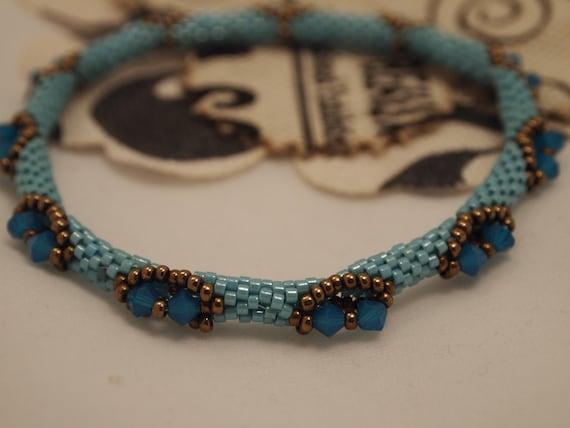 Beaded Bracelet - Indian Charm in baby blue swarovski and bronze