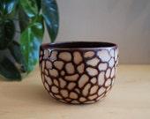 Giraffe pattern vessel