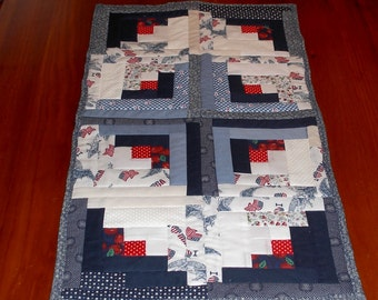 navy blue and white quilted table runner