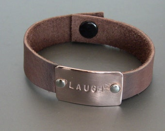 "Brown Leather Cuff bracelet with hand stamped Copper tag ""Laugh"""