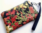 Quilted wristlet in red and black floral cotton fabric with zipper closure