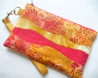 Quilted wristlet in gold and pink batik cotton with zipper closure