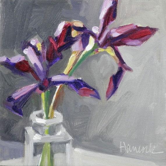 Two Purple Siberian Iris in a Glass Bottle