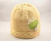 Butter yellow knit baby hat with circle appliqué, preemie