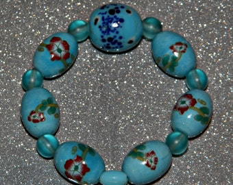 Aqua & Baby Blue Stretch Stackable Friendship Bracelet Glass Ceramic Painted Flower Faberge Easter Egg Beads Unique Sky Water Fairy Mermaid