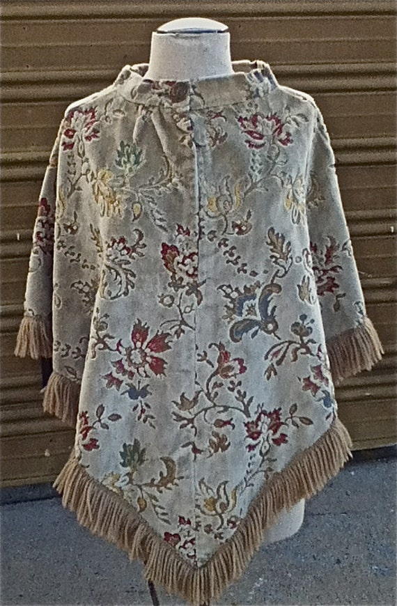 Very Unique 1960's or 1970's Poncho/Cape in cream tapestry, velvet fabric with muted flowers and fringe bottom - one size fits all