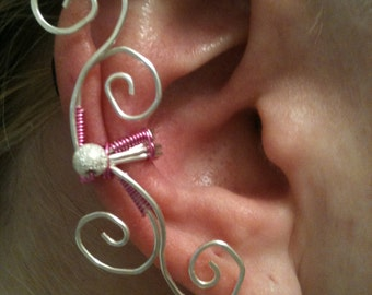 Silver swirl ear cuff with sparkle bead and wrapped in pink wire