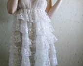 poetry in motion - vintage 60s revived stunning ivory tier lace dress