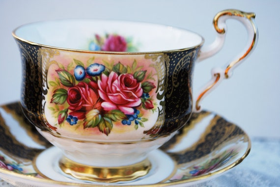 Paragon Tea Cup and Saucer, Black and Gold with Roses