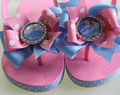 Princess bow flip flops with heel straps -- pink and blue bows