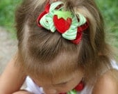 Strawberry hairbow -- Strawberry Shortcake -- Red and lime green strawberry hairbow
