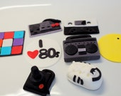 I Love The 80's, 80 s cupcake toppers - 7 qty rubix cube, controller, joystick, boombox, cassette tape, pac man, shoes, and I love 80's