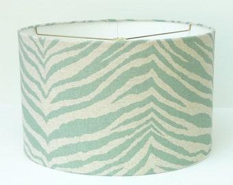 Drum lamp shade in aqua and taupe zebra print fabric