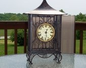 clock, wrought iron, vintage,pagoda/birdcage style, black, patio, sunroom,reduced  20 percent now 55.99