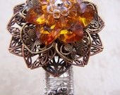 Swarovski crystal flower, filigree and silver bangle bracelet