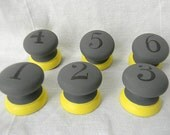 Numbered Gray and Yellow Knobs