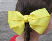large yellow hair bow