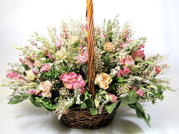 Dried floral arrangement roses galore basket