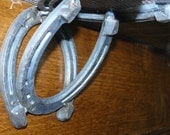 Upcycled horseshoes find a new purpose - brackets