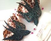 blue swallow burlesque pasties on leopard print ruffle