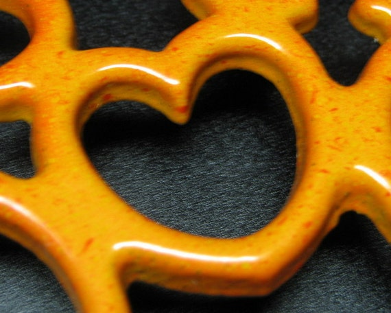 vintage cast iron trivet in flame orange / red baked on enamel possibly Le CREUSET , DESCOWARE or COUSANCES