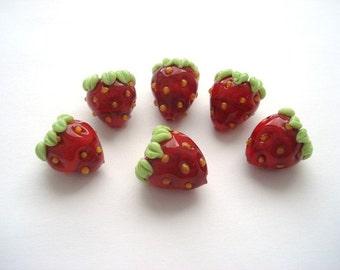 Set of six glass lampwork strawberry beads