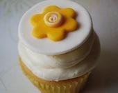Yellow flower on a white fondant cupcake topper