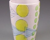 Tumbler with blue triangles and yellow circles