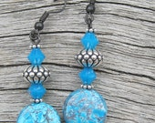 Dangling Earrings of turquoise flat round beads, rich looking silver beads and turqoise crystal bicone beads.